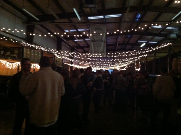 The inside of the event with some great lighting hanging from the ceiling.