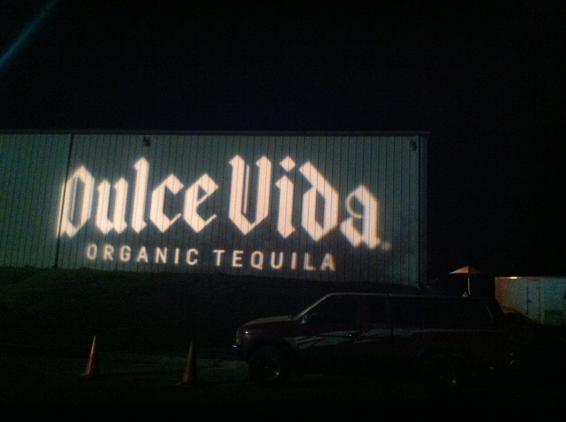 Now that's a way to welcome your guests! A huge logo projected on the side of a warehouse.