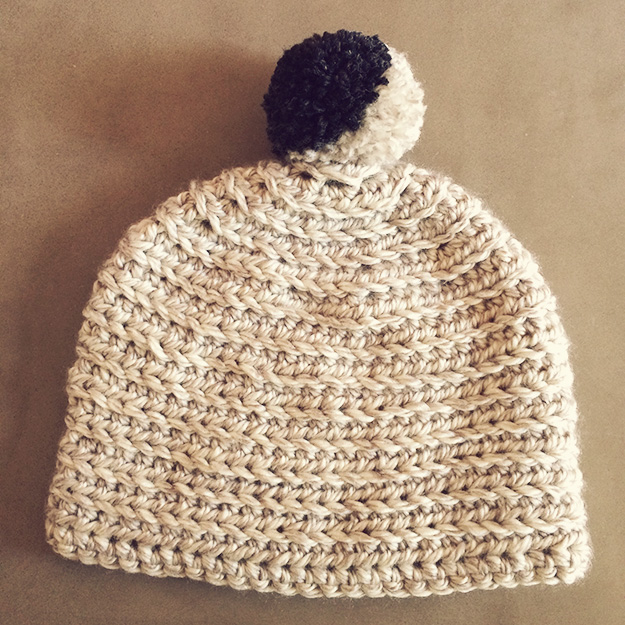 hat with fancy pompom