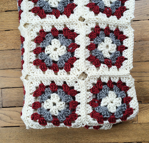 red and grey granny square blanket